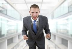 Business man with open arms winning at the office Stock Photos