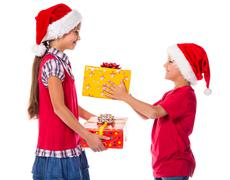 two kids with christmas gift boxes - stock photo