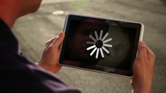 Man Waits for Download on Tablet PC Stock Footage