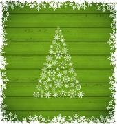 Christmas pine and border made of snowflakes on green wooden background Piirros