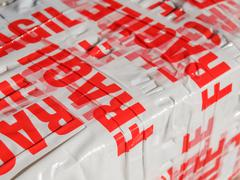 Fragile packet parcel - stock photo