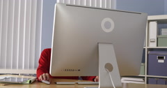 Latin businesswoman working at desk Stock Footage