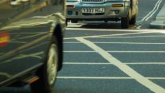 Cars passing by on cross-road Stock Footage