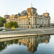 reichstag (bundestag) with reflection in spree river in berlin - stock photo