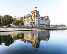 reichstag with reflection in spree river in berlin - stock photo
