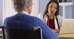 Happy Mexican doctor talking with senior patient - stock footage