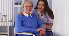 Happy senior woman with friendly Mexican caregiver - stock footage