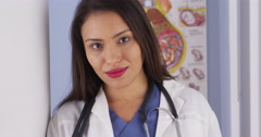 Mexican obstetrician standing in office - stock footage