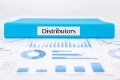 distributor documents, graph analysis and marketing reports - stock photo