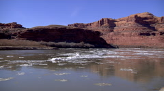 Colorado River Ice Flies Past in Time Lapse Near Moab Stock Footage