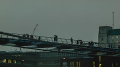 Millenium Bridge in cloudy weather after sunset Stock Footage