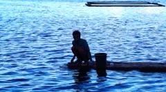 Lake boatman drives bamboo raft Stock Footage
