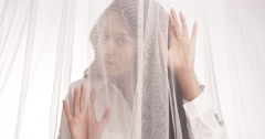 Mexican woman standing behind veil - stock footage