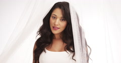 Gorgeous Mexican woman standing behind curtain Stock Footage