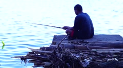Man holds fishing rod silhouette Stock Footage