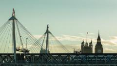 Stock Video Footage of Hungerford Bridge at sunset, Big Ben in the background