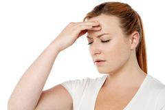 Woman having severe headache Stock Photos