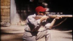 1350 - hunters are shooting rifles in camp - vintage film home movie Stock Footage