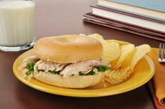 Chicken sandwich on a bagel after school Stock Photos
