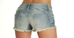 Stock Video Footage of woman swaying hips in denim shorts