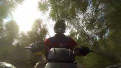 ATV Ride Through Trees Stock Footage
