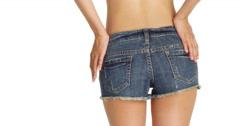 Stock Video Footage of Cute woman wearing denim shorts shaking her bottom