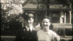 1352 - a soldier on leave hugs & kisses his girl - vintage film home movie Stock Footage
