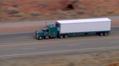 18 Wheeler passing on Highway From Above - stock footage
