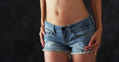 Stock Video Footage of Attractive Chinese woman wearing denim shorts