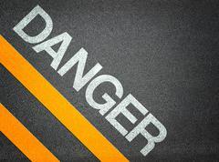 danger text writing road asphalt - stock illustration