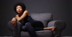 Black woman sitting in armchair - stock footage