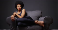 African woman sitting in armchair - stock footage
