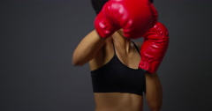 Strong Black Woman Athlete with boxing gloves on dark background Stock Footage