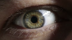 Mysterious blue green hazel human eye close up macro Stock Footage