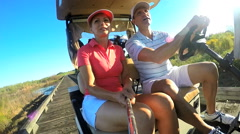 Caucasian Couple Golfer Play Physical Golf Resort Global Sport Transport Buggy - stock footage