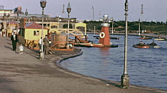 Southend early 1960s: paddle boats at Peter Pan playground Stock Footage