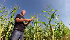 Agriculturist Checking His Corn Crop in Field Stock Footage