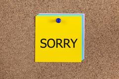 sorry on corkboard - stock photo