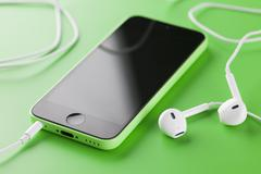 iphone 5c with earpods - stock photo