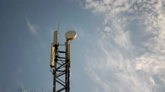 Mobile phone base station antenna tower - stock footage