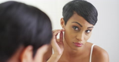Black woman fixing hair and making a face in mirror Stock Footage