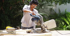 Black woman doing home improvement cutting wood with a table saw Stock Footage
