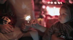 Delightful family lights bengal fires, singing songs and celebrate the New Year Stock Footage