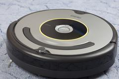 irobot roomba vacuum cleaning robot - stock photo
