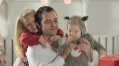 Dad playing with his little daughter with long hair and baby dressed as deer Stock Footage