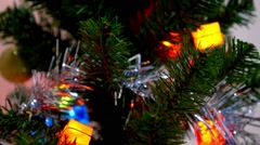 Hand Hanging Decorative Toy Ball on Christmas Tree Branch. Stock Footage