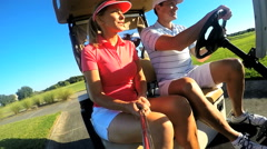 Healthy Outdoor Fitness Exercise Caucasian Couple Golf Player Electric Cart - stock footage