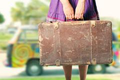 Hippie girl with old suitcase on a road trip Stock Photos