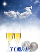 Champagne against holiday lights ang christmas decorations Stock Photos