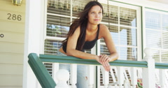 Happy woman leaning on rail Stock Footage